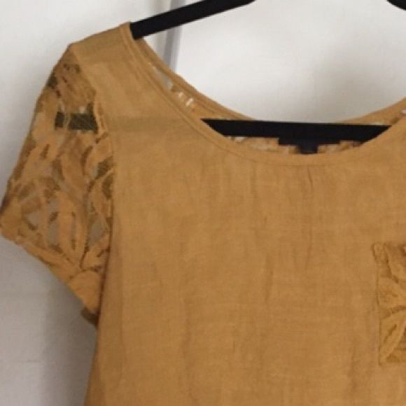 Mustard-colored top Short sleeve with pocket on left side of chest. Back is all lace with faux buttons down the middle. Looks great over a bandeau. Size small, new condition Tops Tees - Short Sleeve