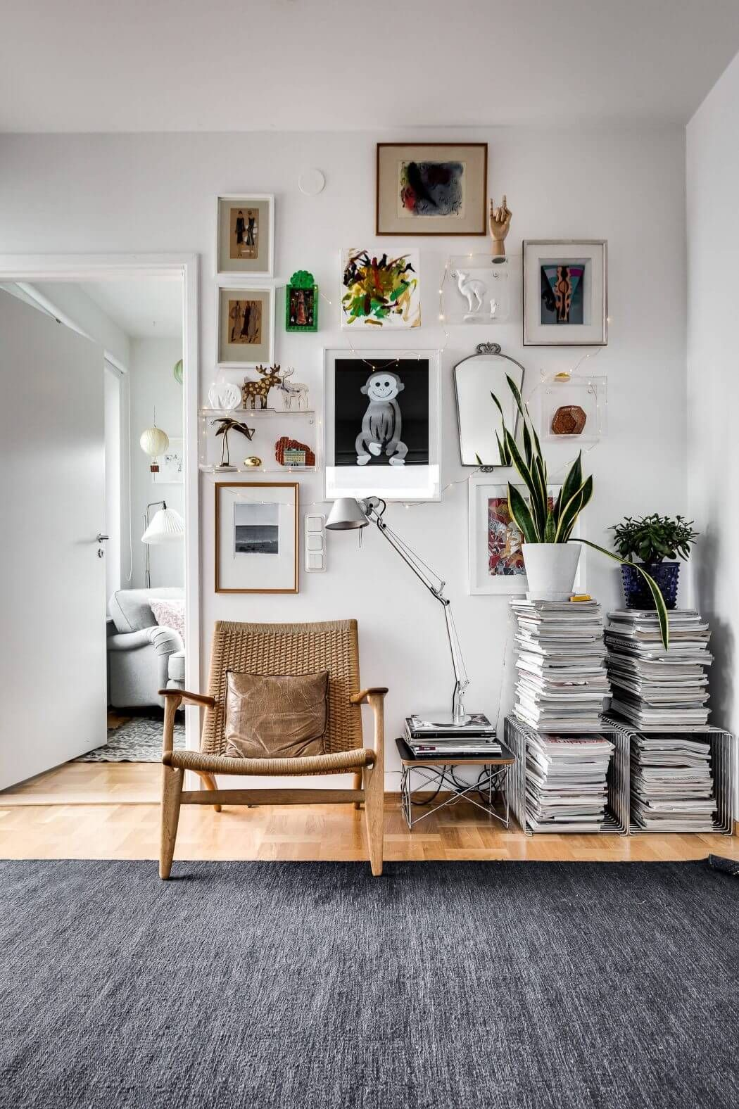 Apartment In Stockholm By Alexander White Gallery Wall And Stacked Magazines