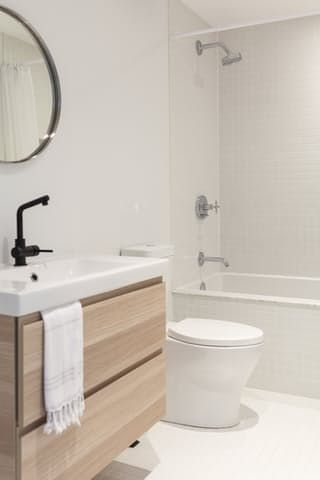 Warm Scandi Inspired Minimalist Perfection In An All White Toronto Home Pretty Bathrooms Scandi Bathroom Bathroom Decor