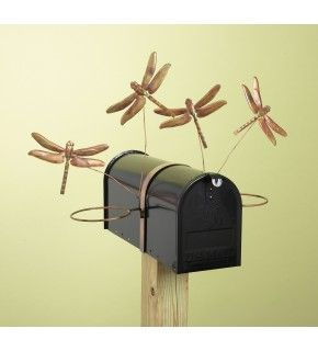 Brighten up your mailbox with this beautifully handcrafted dragonfly mailbox pot holder. The dragonflies will flutter their wings in a gentle breeze. Four 5-inch flamed copper dragonflies adorn the sturdy harness that fits a standard size mailbox and holds two 6-inch diameter pots for flowers or plants. This piece will withstand the elements and will patina over time for a natural look.