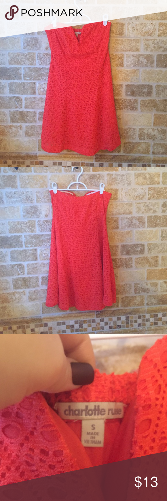 Orange Eyelet Strapless Dress Bright red/orange Eyelet strapless dress from Charlotte Russe! Worn once. Very cute with a big necklace and wedges in the summer. Neck line is a plunge V and there is no zipper. Very stretchy, comfortable, and flattering Charlotte Russe Dresses