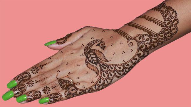Mehndi Peacock Tattoos : Back hand dancing peacock mehndi design trends fashion