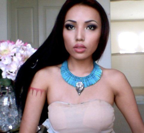 Pocahontas! She looks just like her. This girl is good with make up! I wanna do this for halloween!