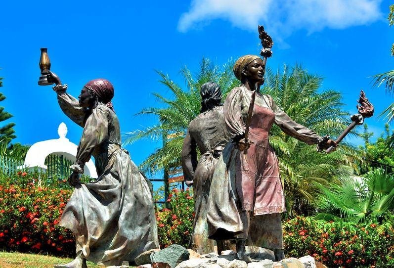 """An image of Three Queens Fountain in the Virgin Island erected to honor the sacrifice of Queen Mary, Queen Agnes and Queen Matilda. They inspired what the locals call """"The Fireburn"""". It is also known as """"The St. Croix Labor Riots of 1878"""". When you think of women of African descent who were freedom fighters...they have to come to your mind. Visit the blog to learn more..."""