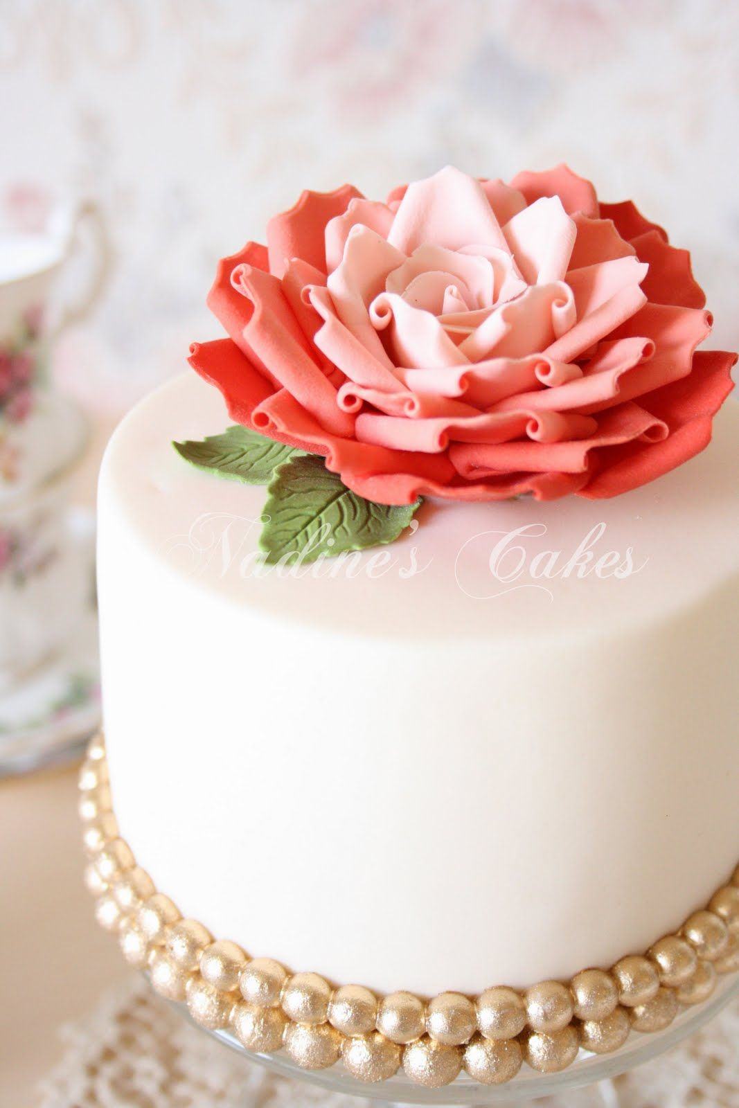 Gold studs make the perfect base for this pretty little ivory and coral cake number. Yum! @Four Seasons Bridal