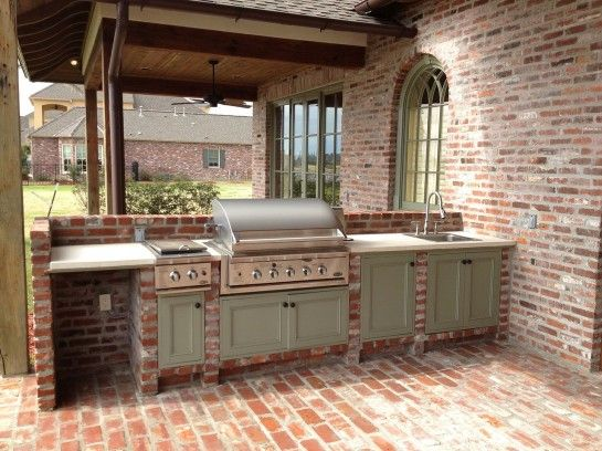 Striking Outdoor Kitchens in Louisiana With Pull Down Stainless ...