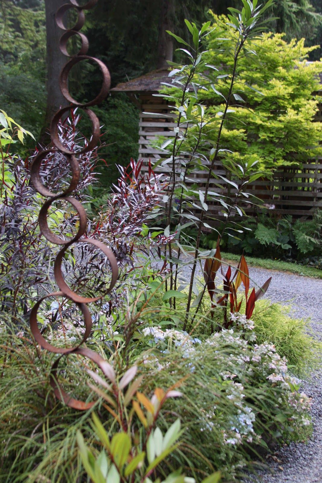 How I love good old rusty iron in the garden - can't wait to
