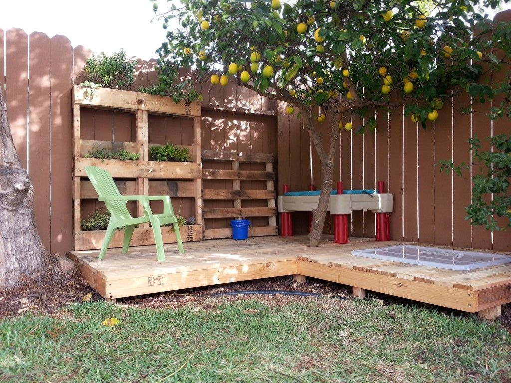 A kid 39 s deck made from recycled shipping pallets with a for Reclaimed wood decking