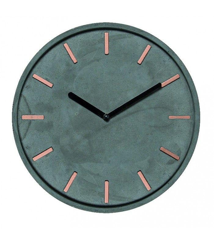 horloge murale ronde en ciment gris et métal cuivre