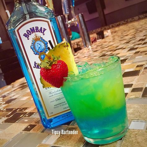 Kalih S Bombay Bombay Sapphire Peach Schnapps Sour Mix Blue Curacao 7 Up Pineapple Juice Gin Drink Recipes Gin Recipes Drinks Alcohol Recipes