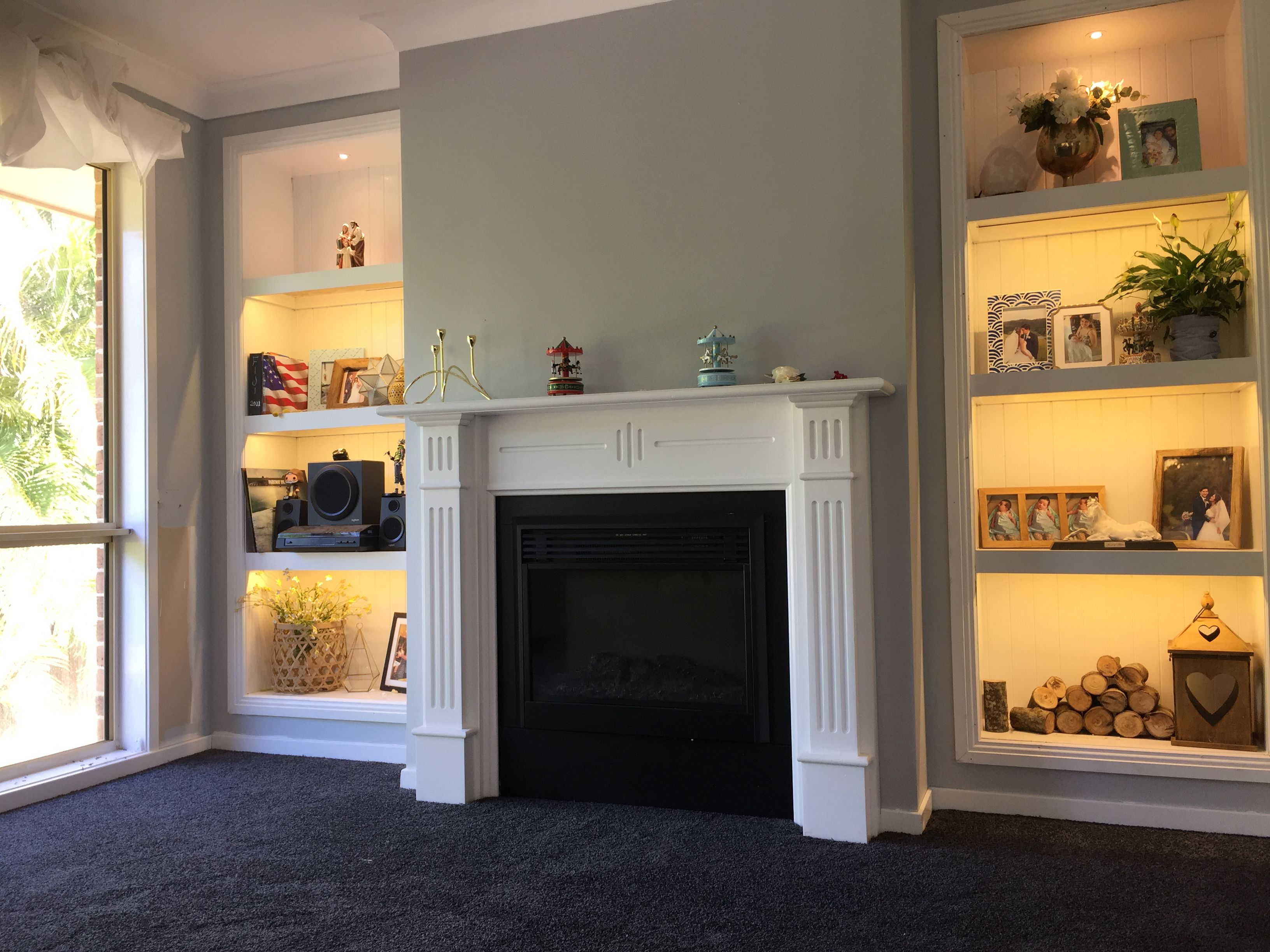 Dark Blue Carpet Grey Walls Electric Fireplace Built In Shelves Book Cases Feature Wall Strip Lighting Charcoal