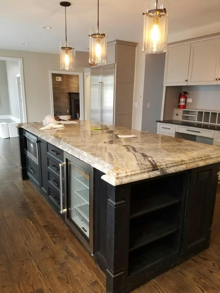 Kitchen remodel design wood cabinets granite backsplash custom home builder house renovations contractor construction interior tiles countertop floors