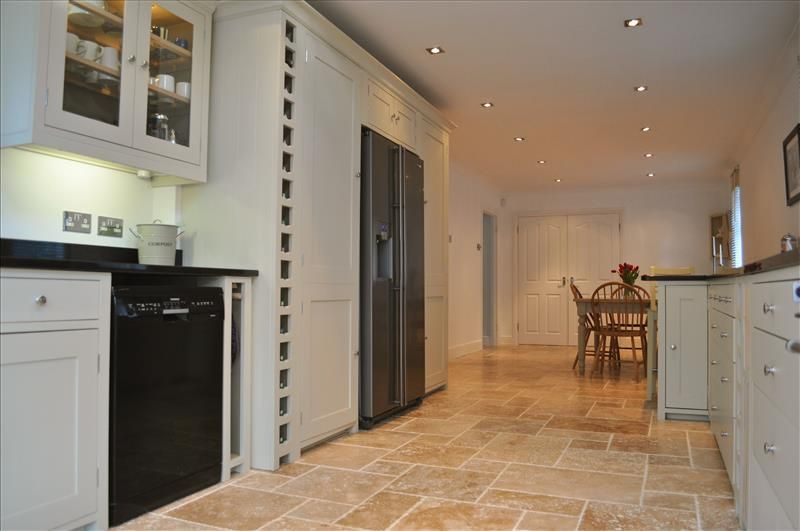 13 Full height larder cabinets provide ample storage space and look ...