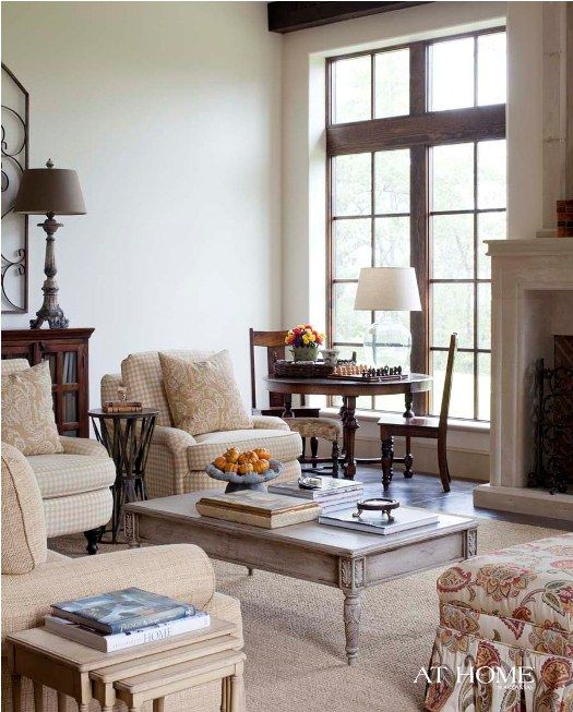 Love the game table nestled at the French doors to let in the light in this living room