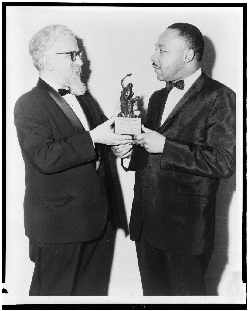 Rabbi Abraham Heschel presenting Judaism and World Peace award to Martin Luther King, Jr.