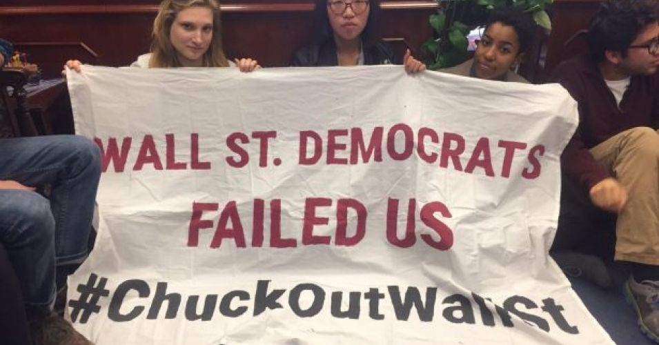 """On November 14, six days after the election of Donald Trump, some 40 young people walked into the office of New York Sen. Chuck Schumer, calling on the senior lawmaker to step aside in his bid to be Senate minority leader. Carrying a banner that read """"Wall St. Democrats Failed Us,"""" they argued that Schumer, who has received more than $3 million in campaign contributions from the securities and investment industry in the last five years, was exactly the wrong figure to lead the opposition to…"""