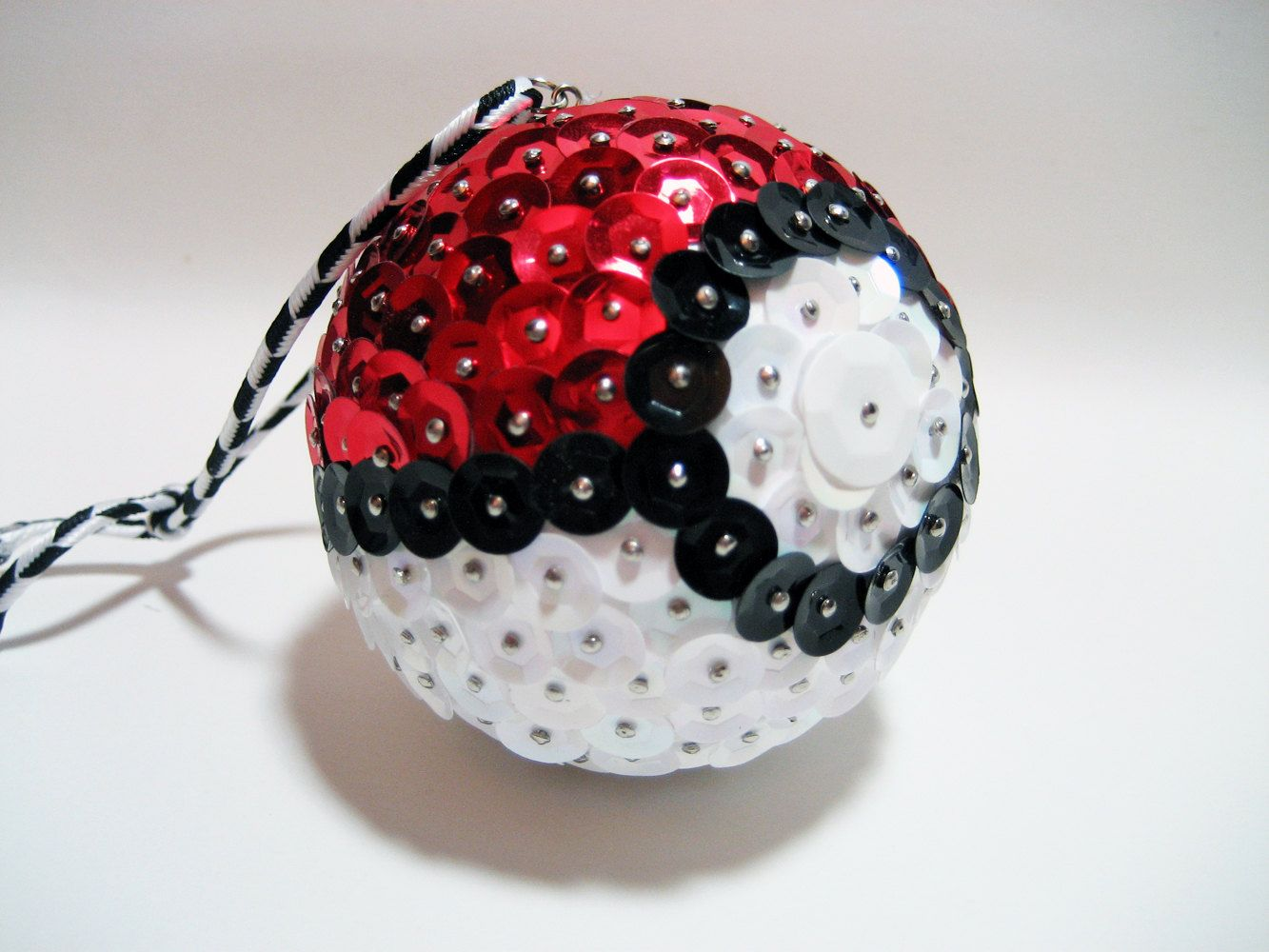 pokemon pokeball ornament red white and black sequin nintendo handmade christmas ornament geek chic geekery video game holidays 1300 via etsy