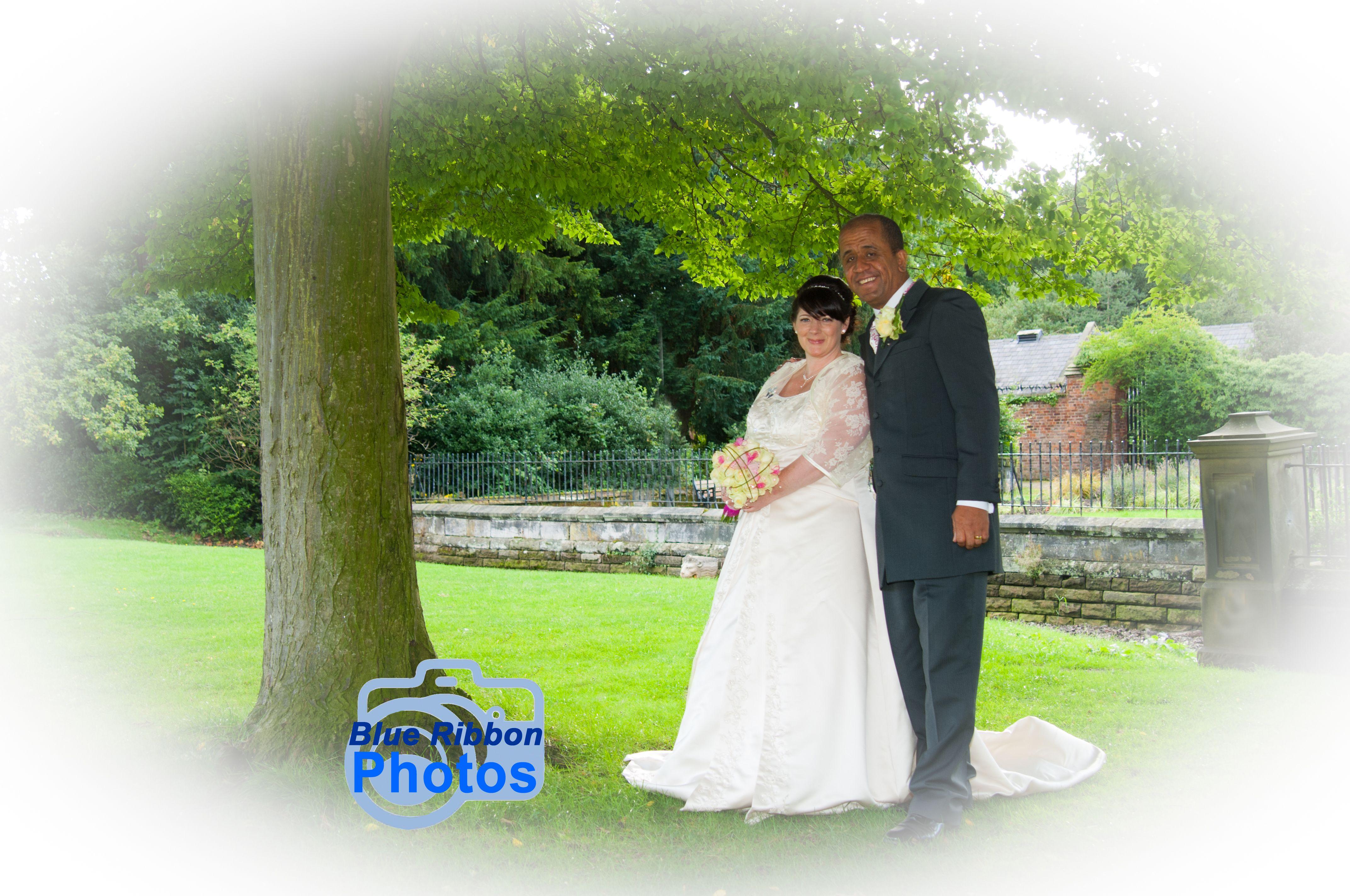 Wedding dresses crewe  Bride u groom pose by a tree at Wythenshawe Hall  Blue Ribbon