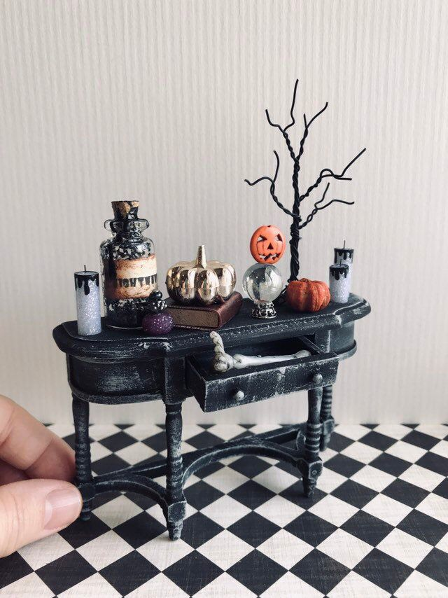 Miniature Halloween sideboard, haunted dollhouse, 1:12 scale miniature furniture #haunteddollhouse Just in time for Halloween! This gorgeous black sideboard is topped with all sorts of creepy things. The candles, potions and handmade tree are especially beautiful! This 1:12 scale piece of furniture is the perfect addition to your haunted dollhouse! It also looks spooktacular displayed on its own. All of the accessories on the cabinet are glued down (the tree is loose) and included with the sideb #haunteddollhouse