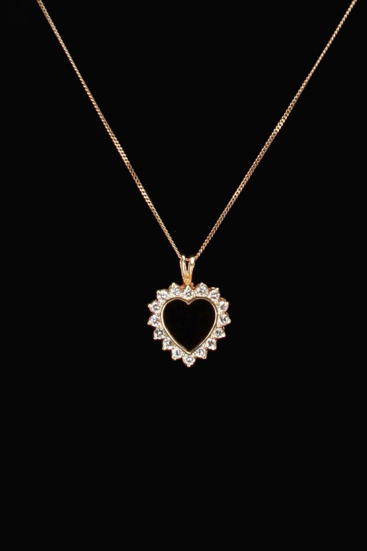 fc2fb25588e0 gold blowout 10k Yellow Gold   0.65 ct Diamond Heart Pendant ...