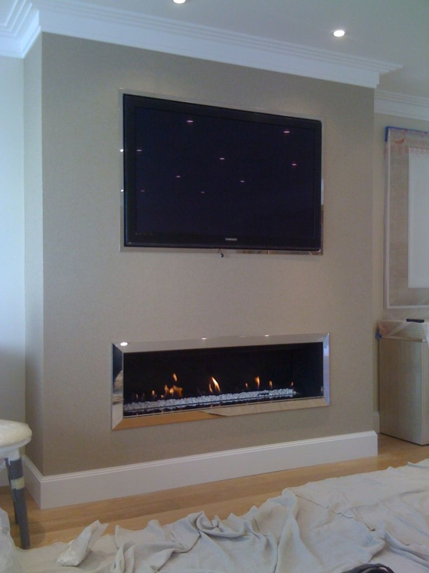 linear fireplace with tile surround and tv above. Black Bedroom Furniture Sets. Home Design Ideas