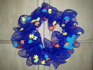 A wreath my son and I made for Autism Awareness month in April.  It will hang proudly on our front door!