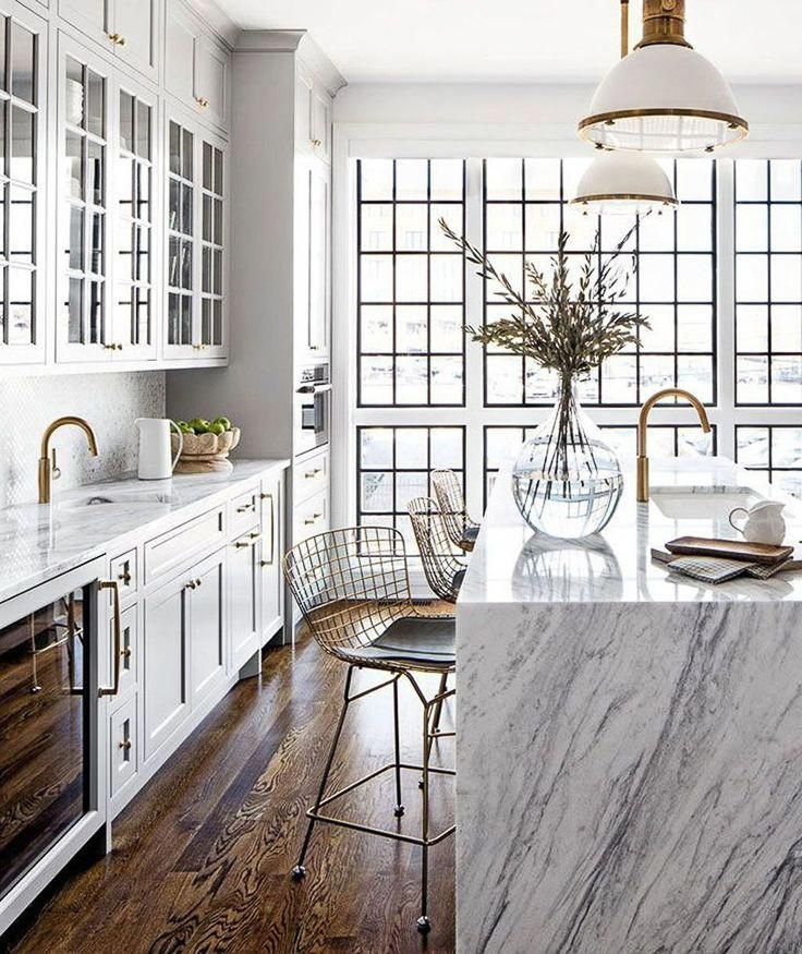 While waterfall countertops are not new, I believe we'll see them popping up in more traditionally inspired kitchens this year.  Kitchen Trends 2019 . #kitchentrends, #luxurykitchens, #kitchendesignideas #kitchenremodels #waterfallcountertop