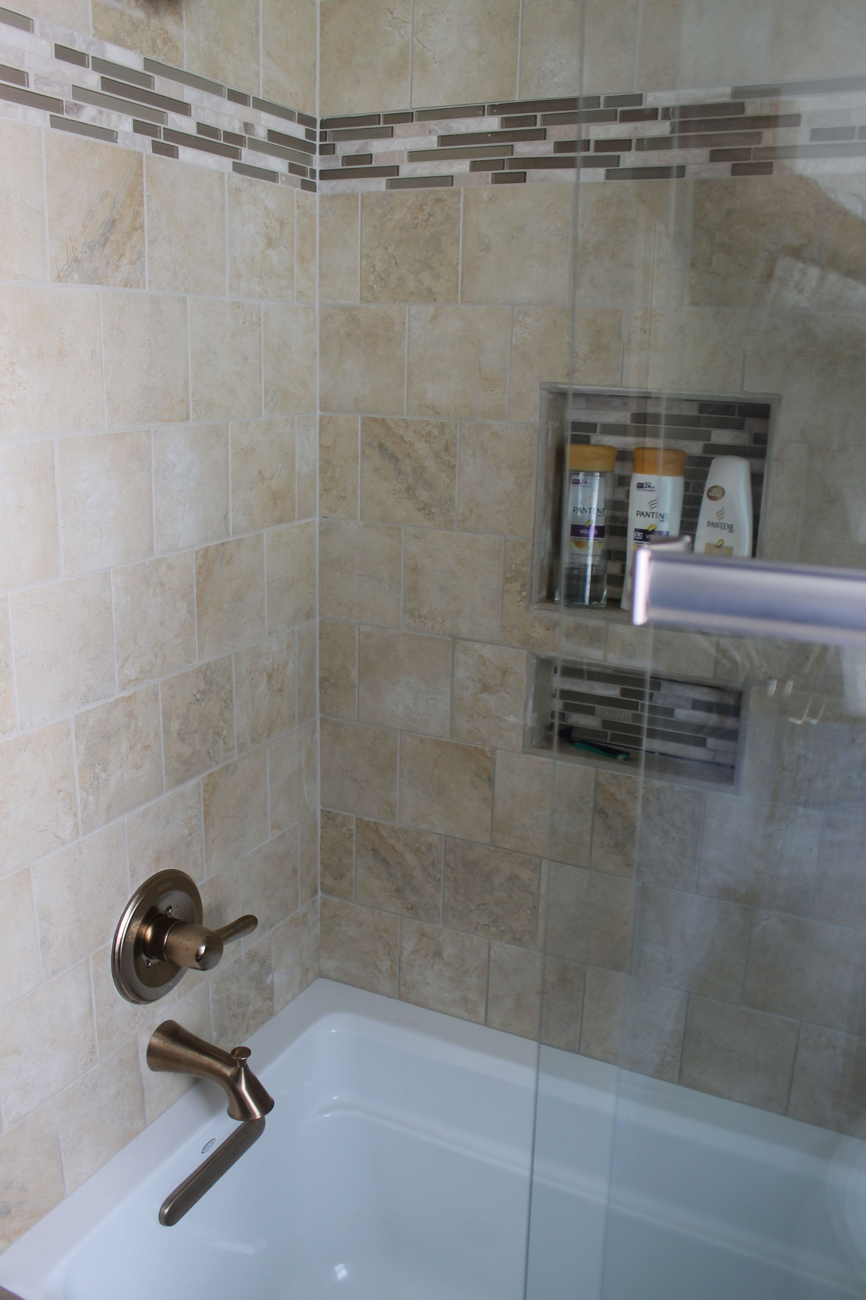 Medium Vanity With Marbelite Top Stainless Fixtures Gl Shower Door And Tile Surround Accent Strips Niches Oak Park Project