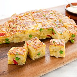 "A Spanish Tortilla - eat it right out of the fridge for that ""first bite in the morning"".  We like to make them in advance for camping, hiking and hunting.  (we put Italian sausage in as well)"