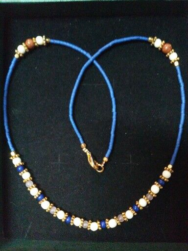blue necklace made from different stones.