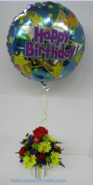 A Great Birthday Gifta Coffee Mug Brimming With Bright Flowers And Happy Balloon To Announce The Occasion