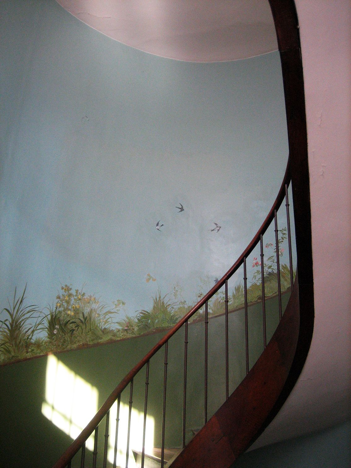 Decorated staircase. Nice to see flowers and birds when you are climbing the stairs