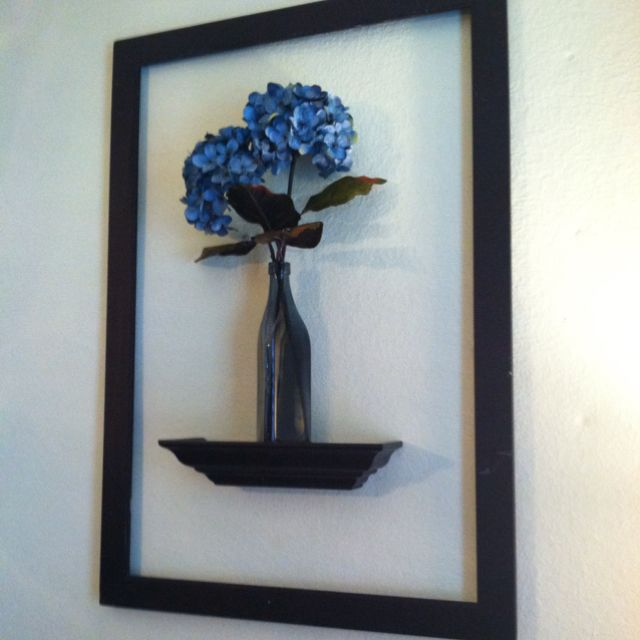made from old frame damaged from tornadoes shelf vase and flowers from
