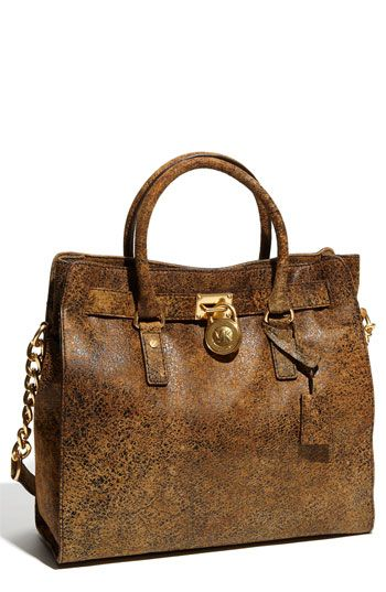 I have this but in more of a large tote style and it looks fabulous w/outfits in the fall/winter!  Compliments skinnies and tall winter boots perfectly!   Chocolate suede boots look awesome with this bag!