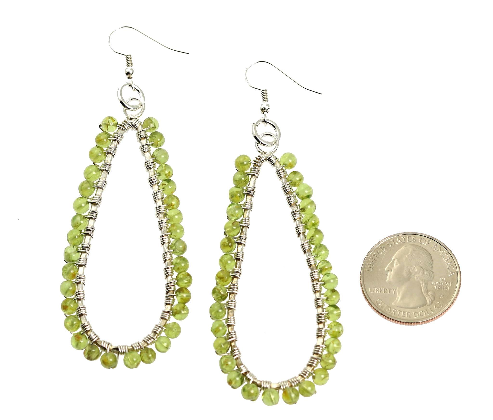 NEW! Cool Hammered Silver Peridot Statement Earrings https://www.johnsbrana.com/products/hammered-fine-silver-wire-wrapped-tear-drop-peridot-earrings #JohnSBrana #SilverJewelry #Handcrafted