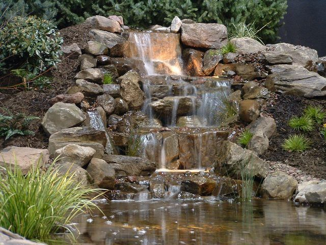 Home and garden show rock waterfall paradise and rock for Garden waterfall design