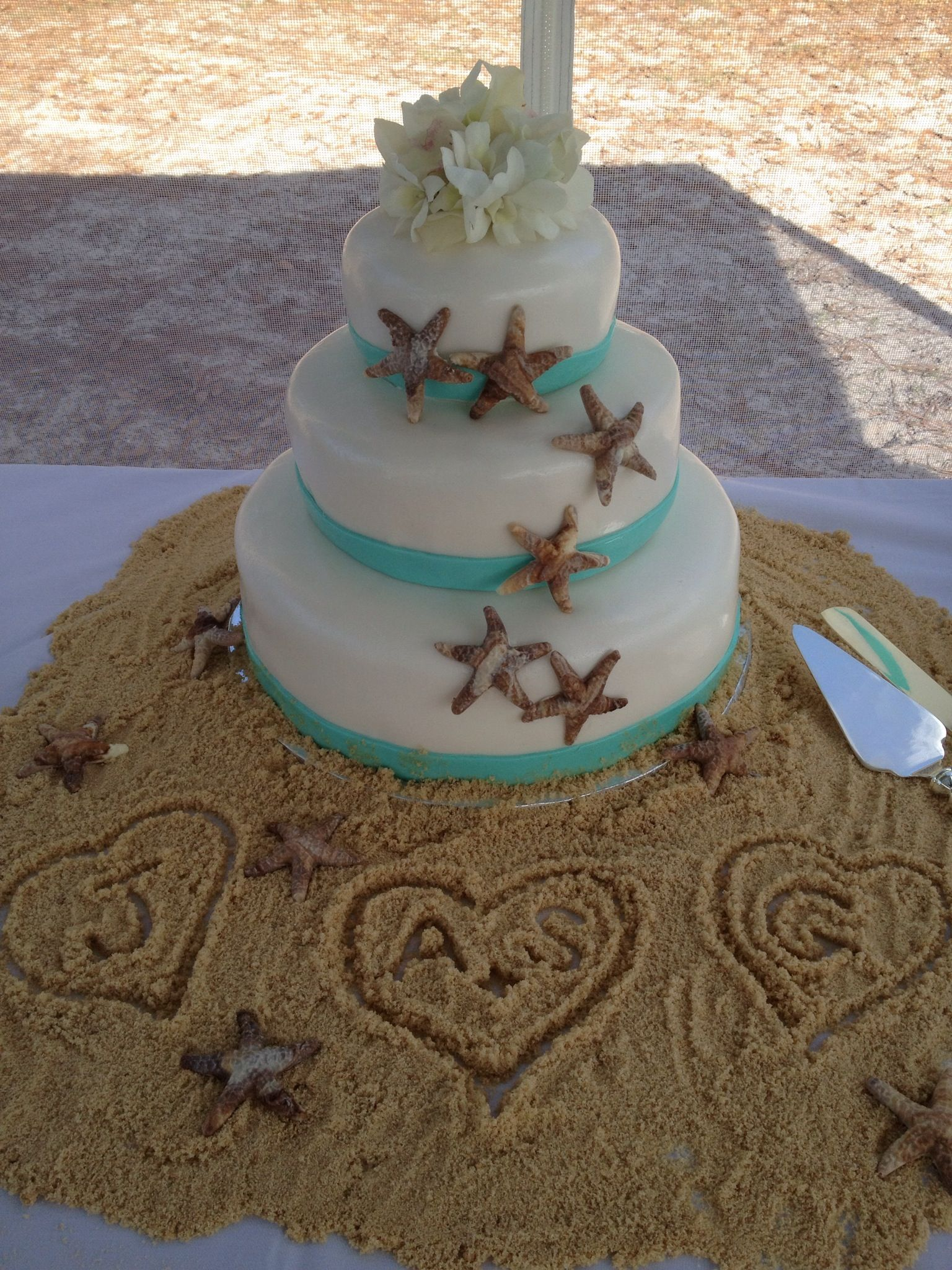 Beach Themed Wedding Cake I Like The Idea Of Sitting It On A Sandy Table