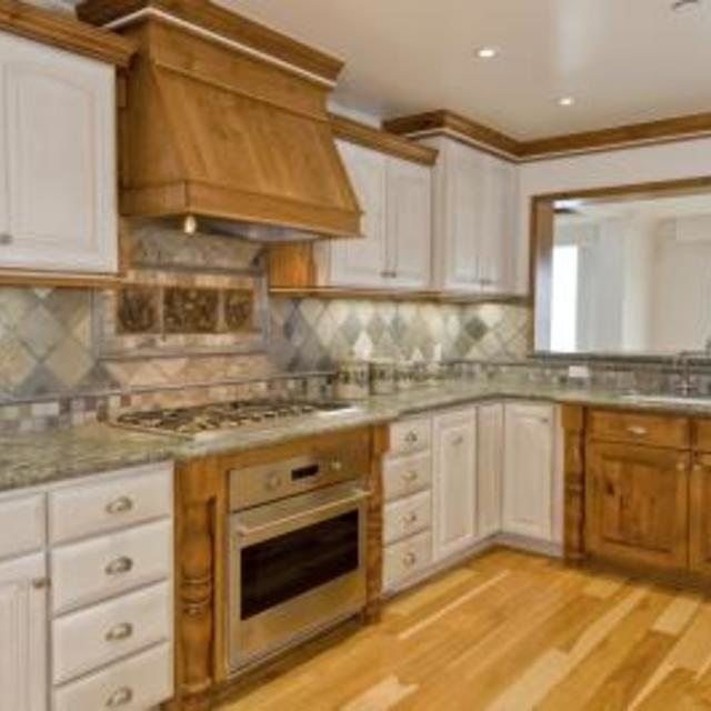 Gray And Tan Granite Countertops Compliment Honey Toned
