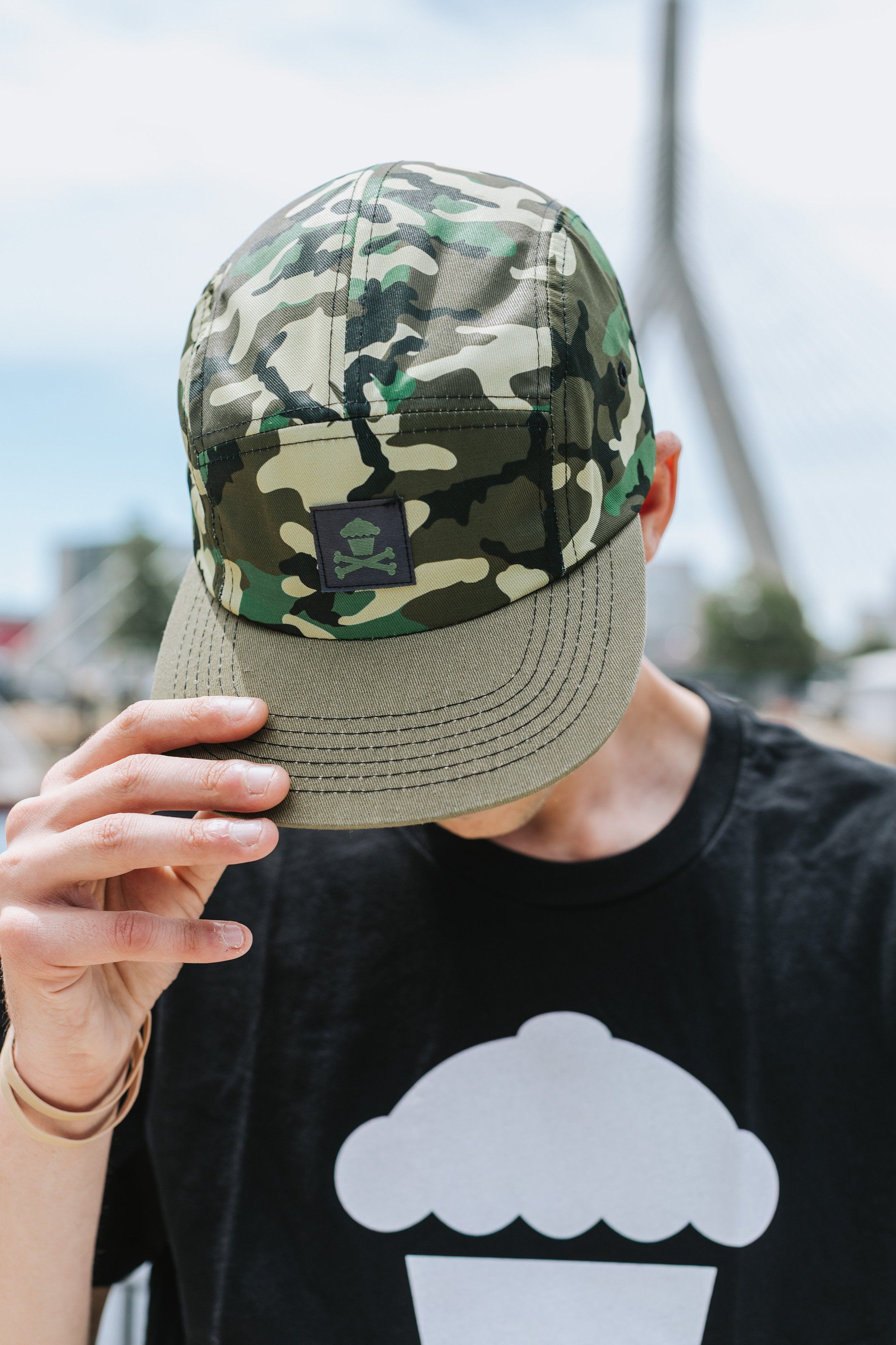 4e3fc4fe17e2e Our 5-panel adjustable camo hat makes for a great addition to your Johnny  Cupcakes wardrobe! Accessorize by matching with our camo windbreaker!