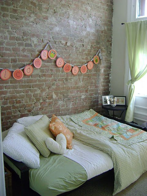 and exposed brick  futon is smart  love the green and orange  and exposed brick  futon is smart      rh   pinterest