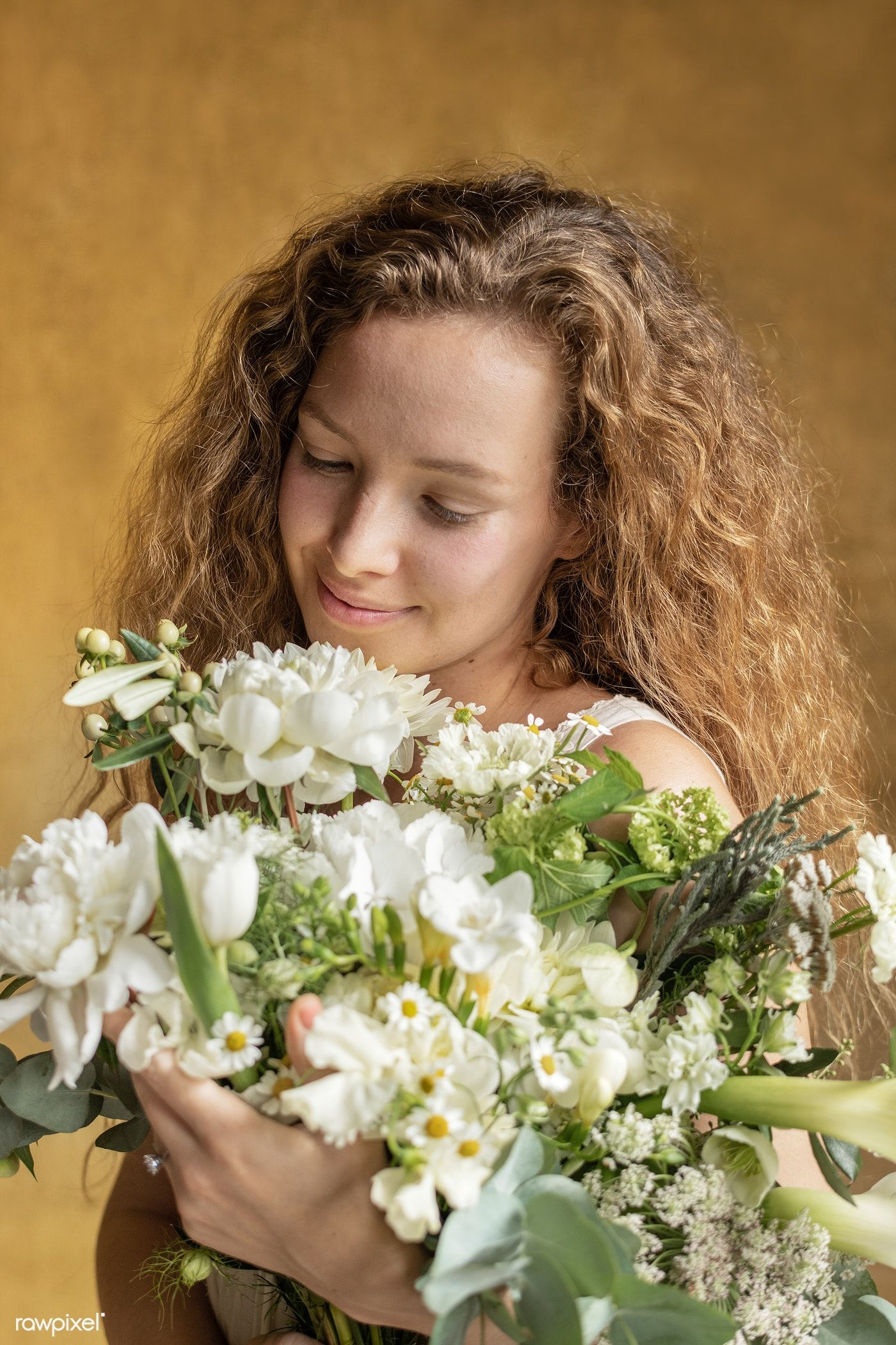 Download premium photo of Woman holding a bouquet of white