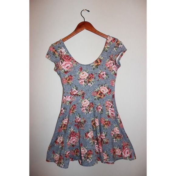 PRICE REDUCTION! Cute Floral Dress This short, fun dress is perfect for the summertime. The fabric stretches, making this a very comfortable, casual dress. Dresses