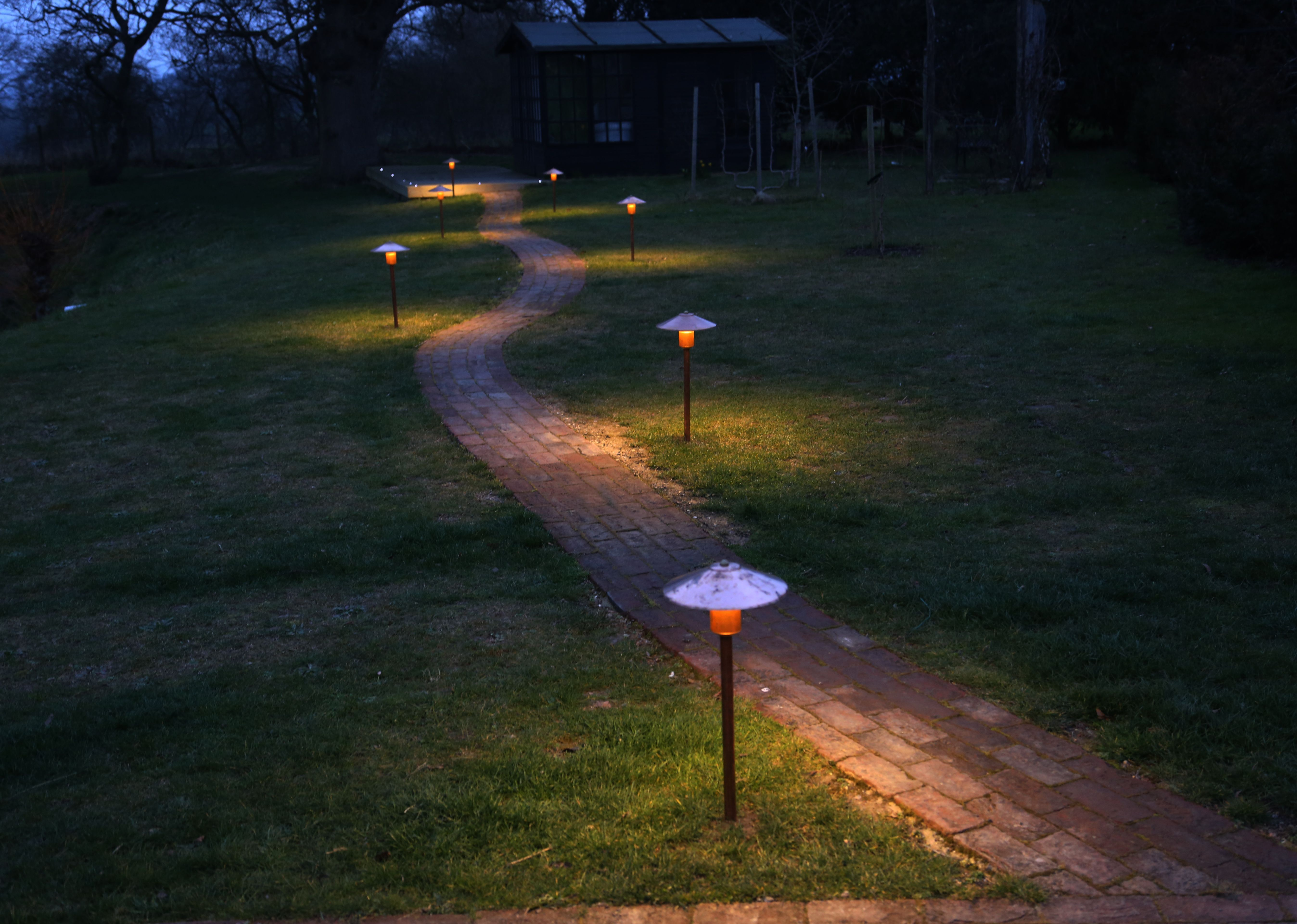 Hunza Solid Copper Tier Lights Were Used To Illuminate The Path To This Summerhouse Outdoor Lighting Path Lights Garden Lighting
