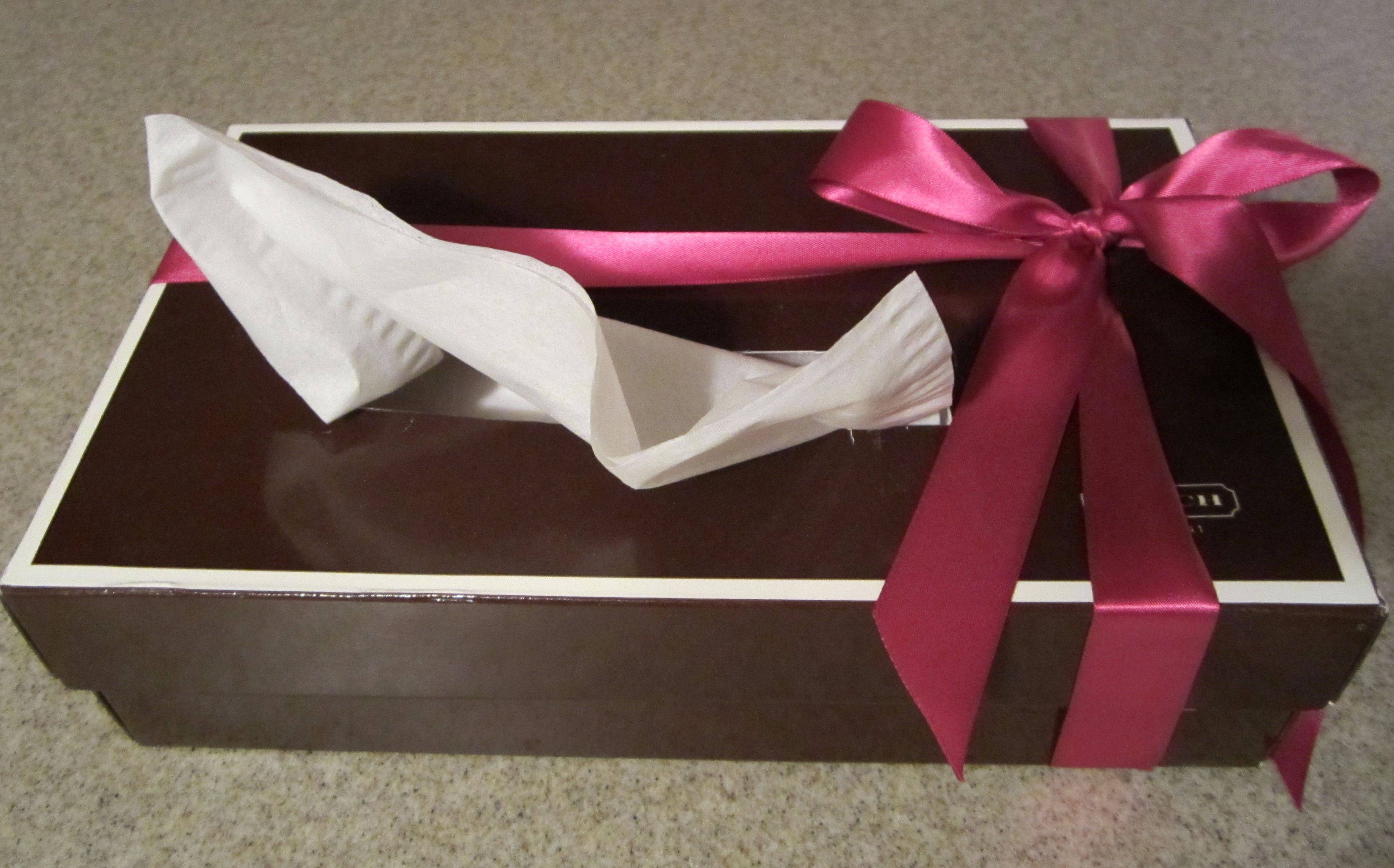Turn designer gift boxes into fancy tissue boxes! (doubt I will, but cute idea; how about a red Macy's box?)