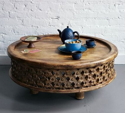west elm carved wood coffee table.  probably too earthy for J, but nice texture, color and shape.