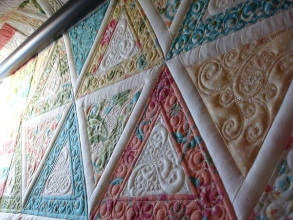 Triangles, machine quilting by Jane O. by Cloud9