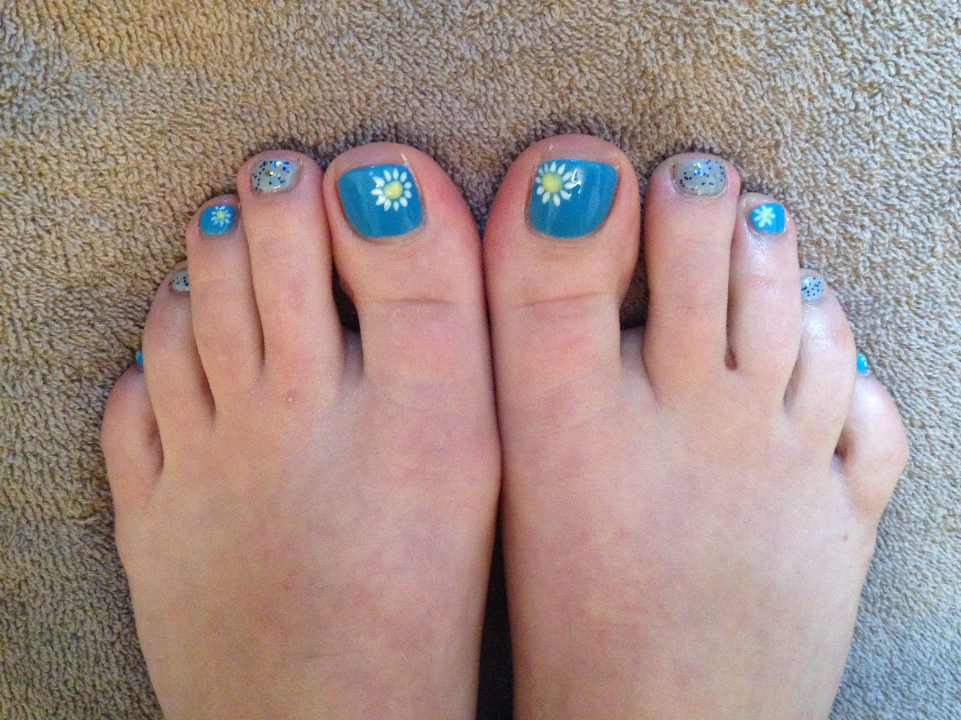 Blue toe nails with freehand daisy nail art and grey with blue ...