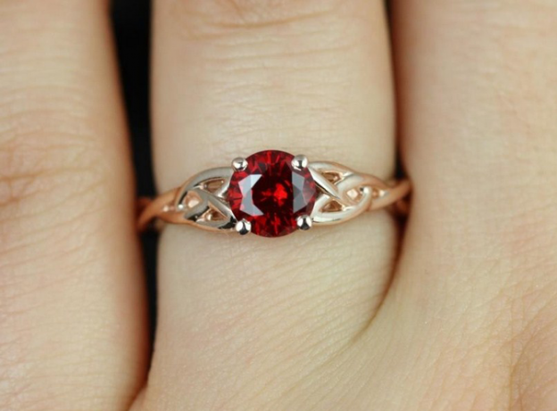 ruby engagement ring with gold on finger 624x461