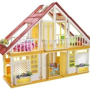 The Barbie Dream House in the '80s and '90s vs. The Barbie Dream House today, which recently got a renovation. | Here's What 23 Of Your Childhood Toys Look Like Now