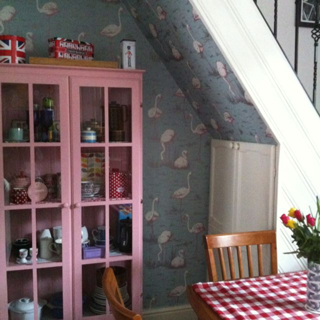 Pastel Kitchen  With Cole And Son Flamingo Wallpaper And Antique Rose  Painted Glass Cabinet.